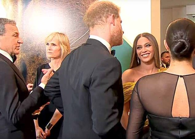 The Mail on Sunday last week unearthed video of Prince Harry touting his wife's voiceover skills to Disney boss Bob Iger (far left) at the event in July