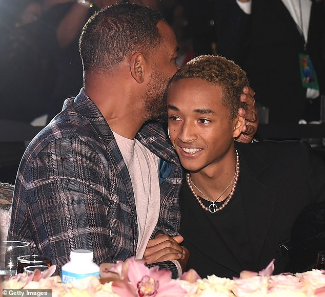 Supportive dad: Dear old dad kissed Jaden on the head as his son was called up to the stage to accept his award