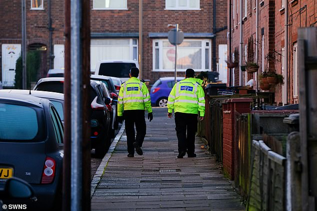 A ten-year-old boy was stabbed on Belper Street, Leicester. Pictured: Police at the scene