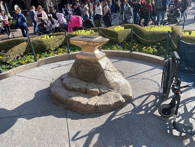 Disneyland cast members tapped over the Excalibur's empty hole after Sam reportedly broke the sword during his attempt