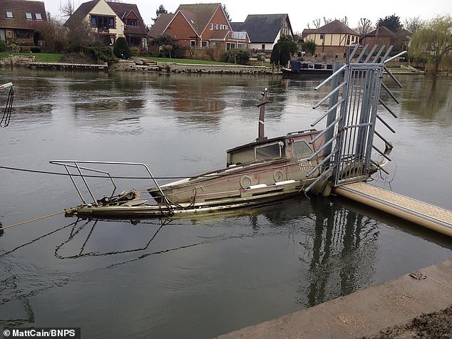 Disaster struck when it sank at its mooring in Windsor, during the floods of February 2014 (pictured)
