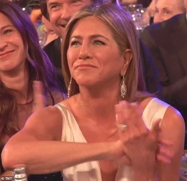 If anyone would know: The camera then cut to Jennifer, who could be seen clapping at the joke and pulling a face of wry recognition