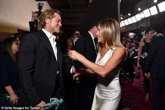 No hard feelings: She and her ex-husband Brad Pitt were glimpsed having a friendly backstage meetup and sharing a laugh during the ceremony