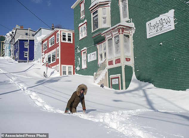 A resident makes their way through the snow in St. John's, Newfoundland on Saturday in the highest snowfall