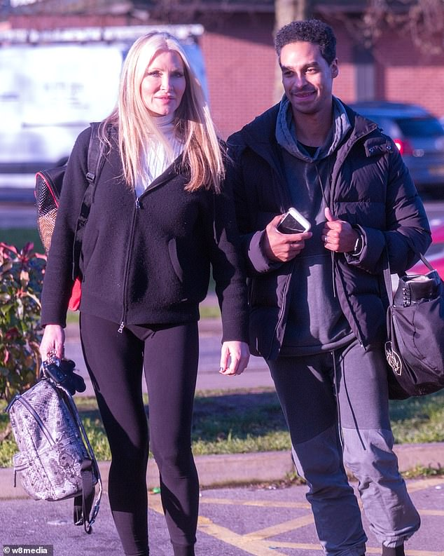 New pro? Her companion - believed to be her new pro partner - wore a grey tracksuit