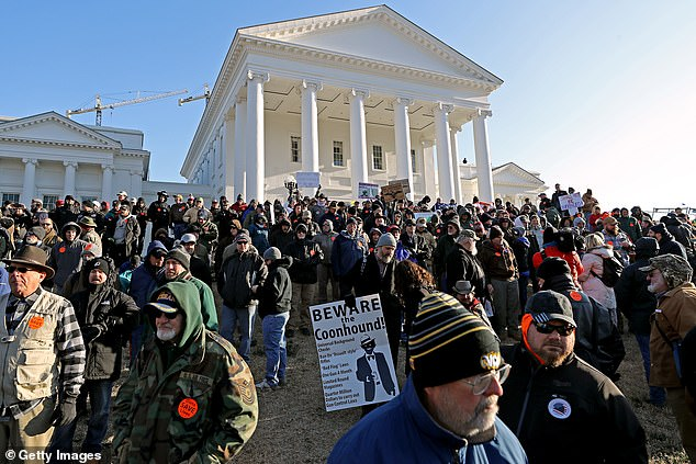 Thousands of gun rights advocates attend a rally organized by the Virginia Citizens Defense League on Capitol Square near the state capital building to protest proposed sweeping gun control laws, including limiting handgun purchase to one per month