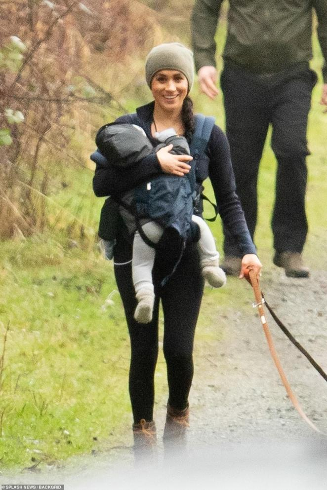 Meghan Markle is the picture of a happy mom as she enjoys a casual stroll through a neighborhood park this morning