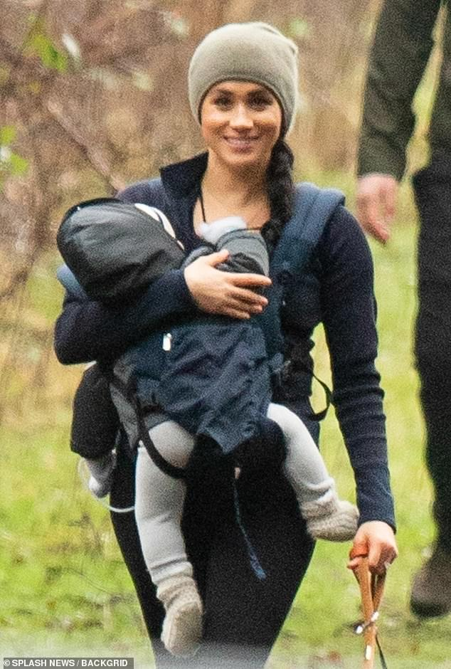 Doting mom: Meghan was all smiles as she carried baby Archie on her chest in a sporty $180 Ergo 360 Omni carrier during their walk