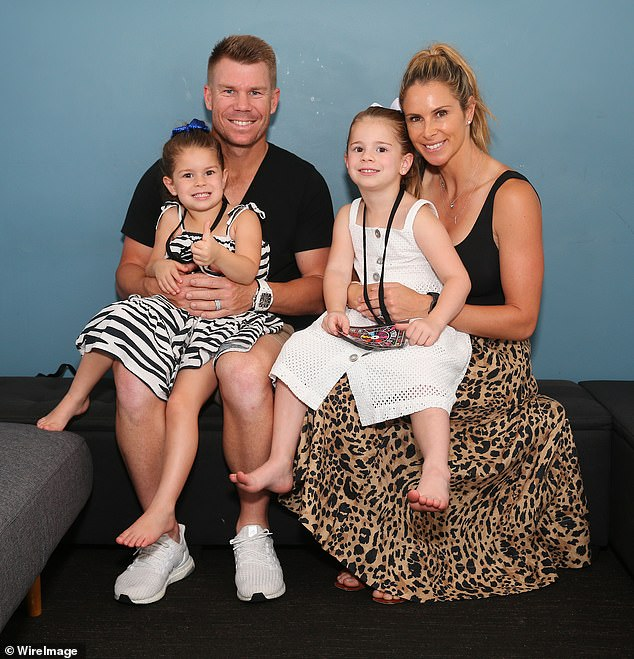 Family fun! David Warner was all smiles as he attended the DreamWorks Trolls World Tour with his wife Candice and their daughters Indi Rae, three and Ivy Mae, five on Tuesday