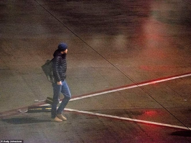 He was seen leaving the Boeing 747 by the back staircase wearing a blue beanie and jeans with a backpack over his shoulders. Two security guards escorted him