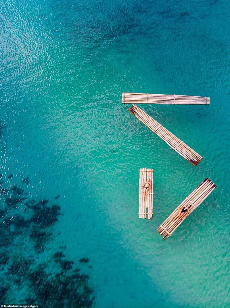 Alan Mills, from London, captured a snapshot of paradise – two friends floating side by side in Port Barton Palawan in the Philippines.  'I wanted the girls to have a photo that would sum up the day, and to show their friendship from another point of view,' he said