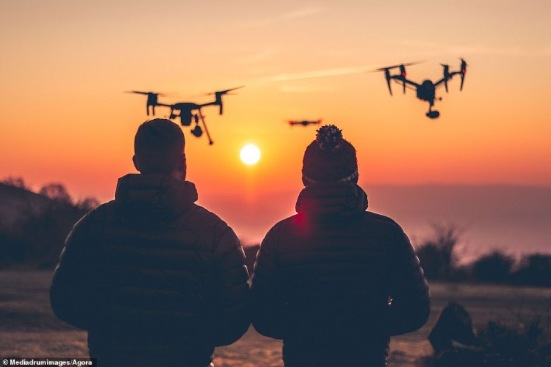 Kieran Hanlon is pictured alongside his father in Somerset, enjoying their favourite pastime, flying drones. He said: 'My dad is my best friend and we run the @Keanudrone Instagram account together'