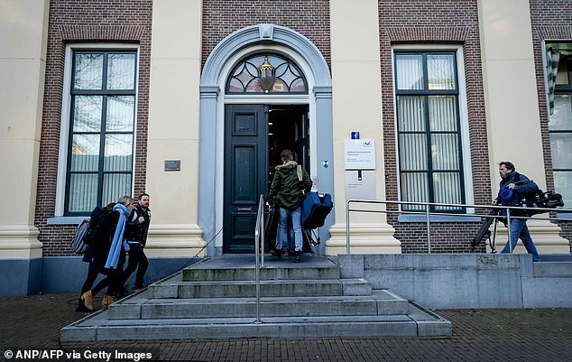 Journalists arrive at the court in Assen on January 21