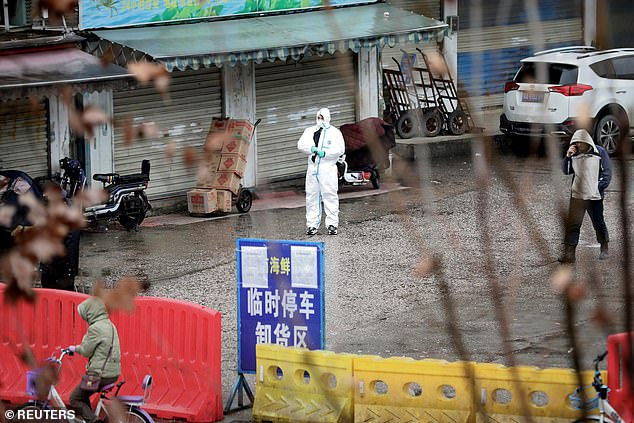 The new Chinese coronavirus which has killed six people may have been lurking in animals for decades, leading expert Sir Jeremy Farrar believes. Pictured, the closed seafood market in Wuhan, China, which is being investigated as the source of the virus