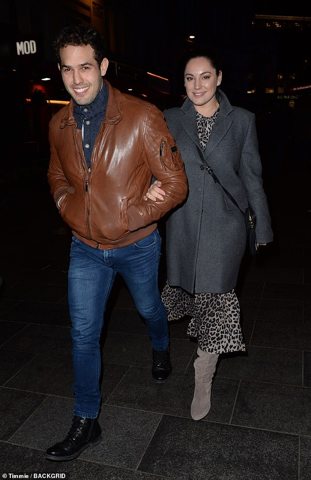 Couple:Kelly Brook, 40, and her boyfriend Jeremy Parisi, 34, looked in good spirits as they stepped out for a stroll in London on Tuesday evening