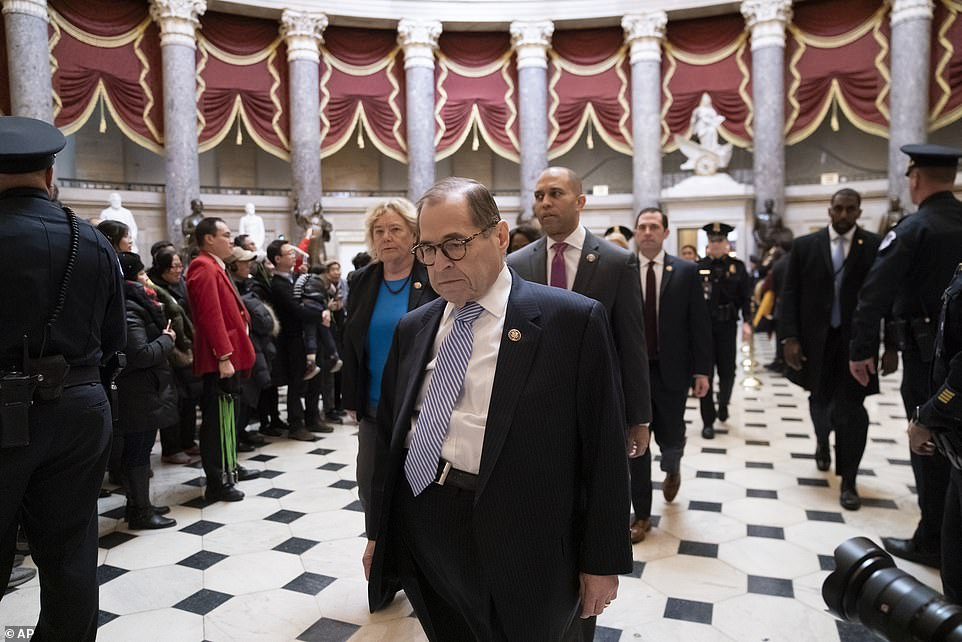 House Democratic impeachment managers, Judiciary Committee Chairman Jerrold Nadler, D-N.Y., flanked by Rep. Zoe Lofgren, D-Calif., left, and Rep. Hakeem Jeffries, D-N.Y., arrive for a news conference at the Capitol