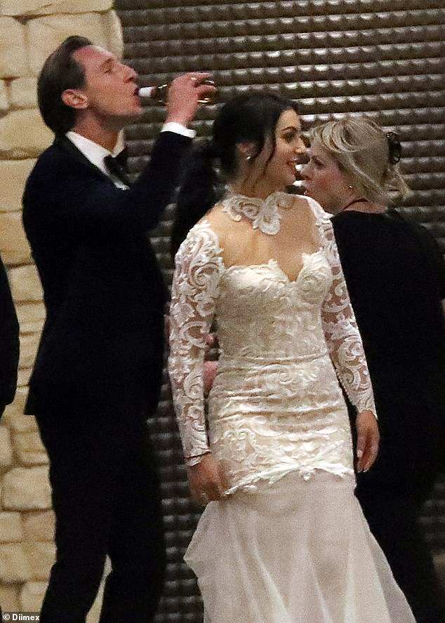 Feeling better? Groom Ivan was later seen drinking a beer next to his bride as she smiled