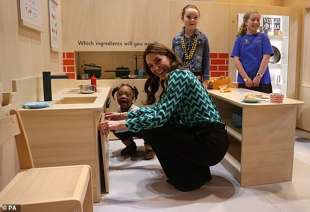 The Duchess of Cambridge appeared without a care in the world as she spent time at the MiniBrum, an interactive, child-sized mini-city at Thinktank, Birmingham's science museum