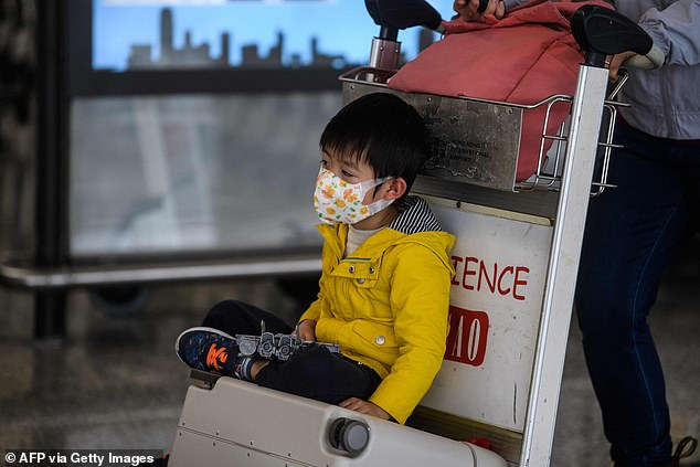 A child wears a face mask at Hong Kong's international airport today