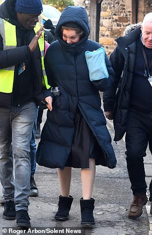 Wrapped up: Olivia Colman was also spotted arriving on set in an oversized coat to film scenes for Lord Mountbatten's funeral