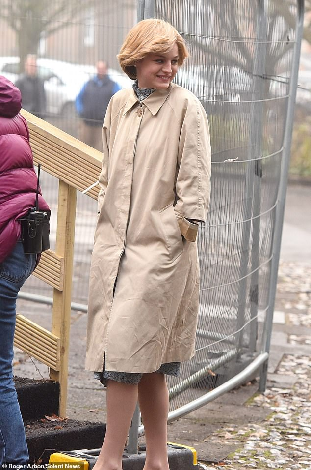 Princess: Emma, 24, channeled the princess-to-be in a beige rain coat over a blue patterned dress for the shoot with white court shoes and a wig styled into Diana's signature short style