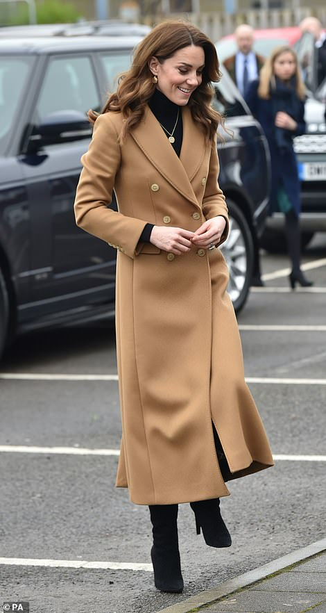 Kate smiles as she arrives for her visit today
