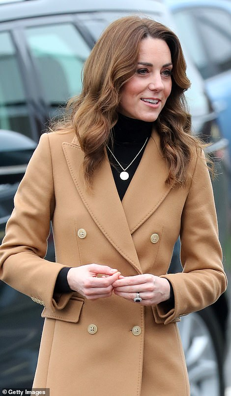 Kate smiles following her arrival in Cardiff today