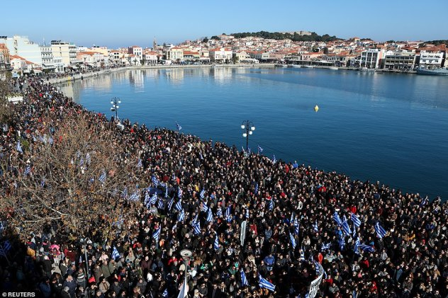 The islands of Lesbos, Samos and Chios staged a general strike, shutting down shops and public services and rallying in central squares, many protesters waving Greek flags (pictured: thousands on the streets of Mytilene on the island of Lesbos in Greece on Wednesday)