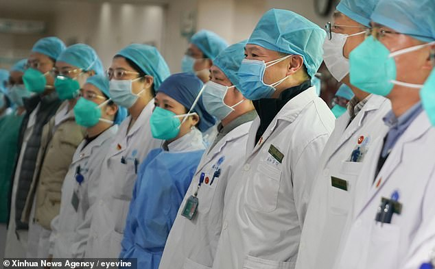 The new coronavirus has not had fatality rates as bad as those of its cousin, SARS, but experts say this could change. Pictured: Staff of Union Hospital attend a ceremony to form a 'assault team' in the fight against coronavirus in Wuhan, central China's Hubei Province