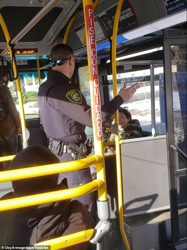 Police eventually come and escort the woman off the bus