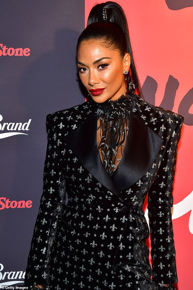 Stunner:To help show off her ageless complexion, she wore her hair scraped into a tight ponytail and made sure her make-up was totally flawless