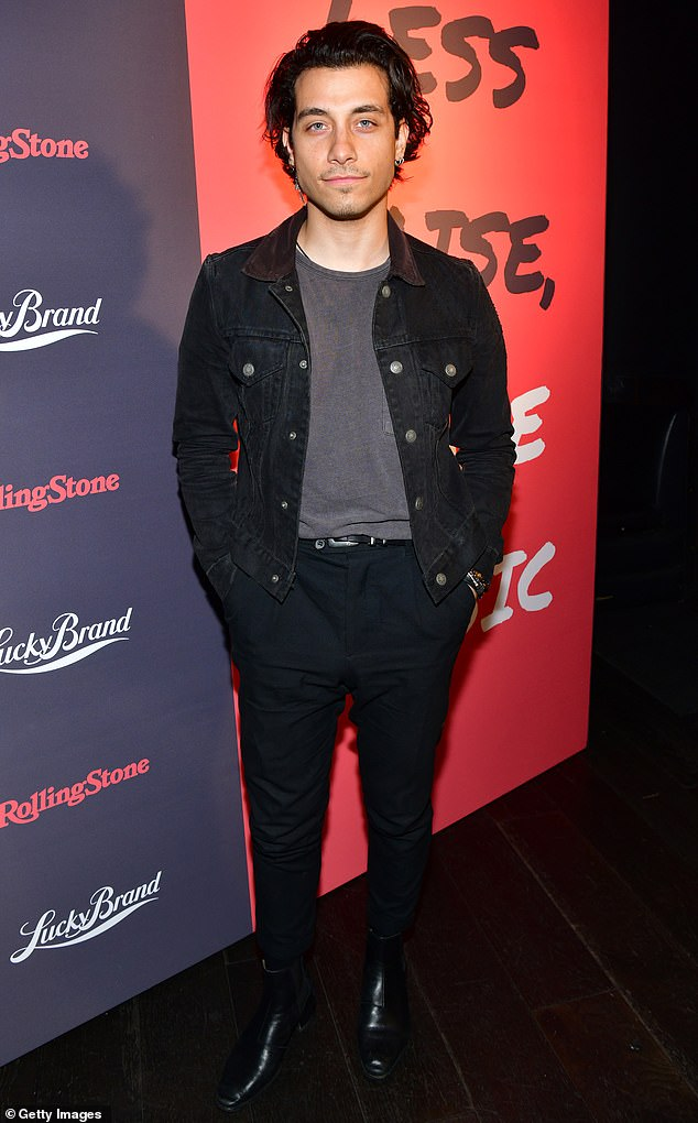 Stylish:Rob Raco cut an edgy figure in all-black