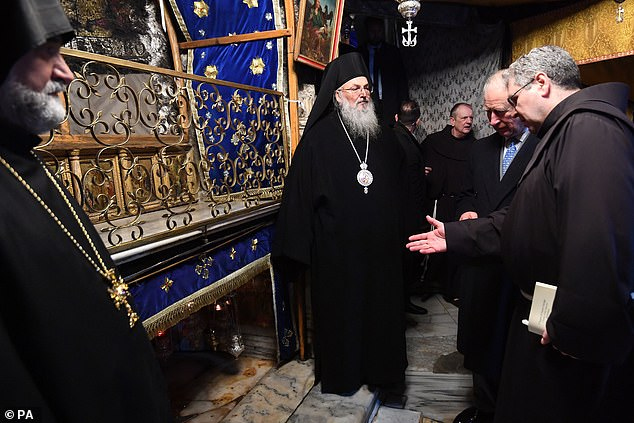 The Prince of Wales (second left) is shown the manger during a visit to the Church of the Nativity in Bethlehem on the second day of his visit