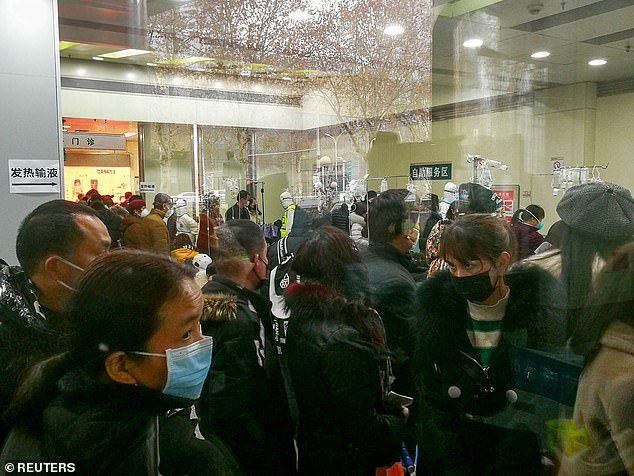 People queue to receive treatment at the fever outpatient department of the Wuhan Tongji Hospital in Wuhan on January 22.The local government today said that the city was witnessing a surge in the number of its fever patients and that hospitals were running out of beds