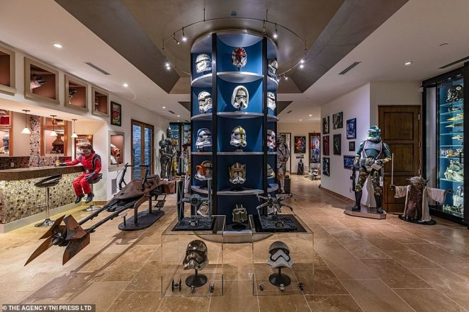 Star Wars memorabilia can be seen throughout the house, with masks, posters, replica weapons, space ships and characters lining the walls and corridors