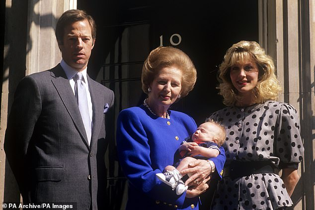 Family: Prime Minister Margaret Thatcher cradles her grandson Michael outside 10 Downing Street. Also pictured are Mark (left) and his wife Diane (right) (pictured in 1989)