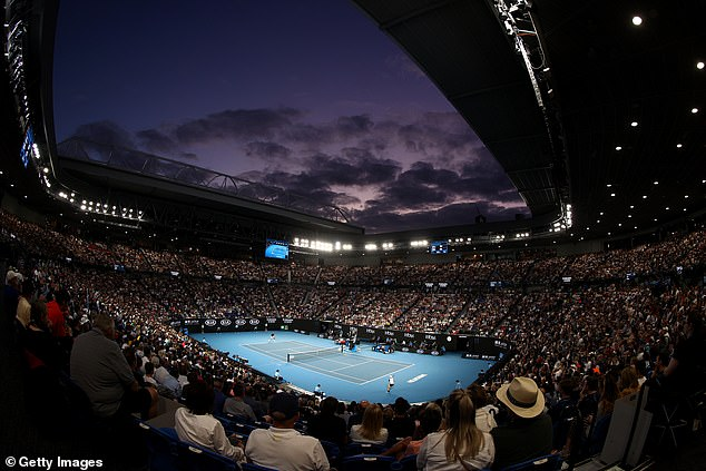 The night sky can be seen overhead as Federer and Millman begin their third-round match