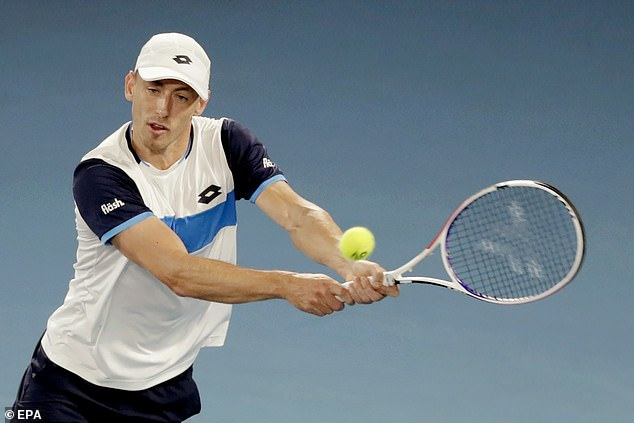 Millman looks to play a backhand shot back into court during his battle with Federer