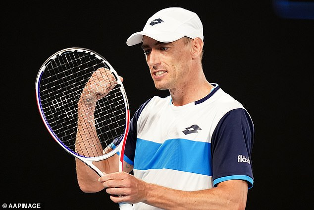 John Millman vents his frustration on his racket as he throws away a third-round victory