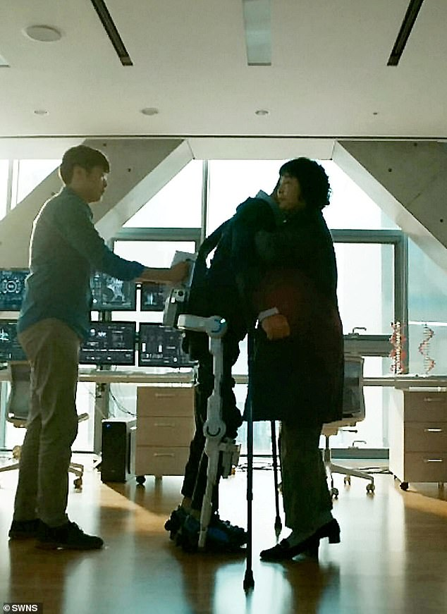 In the heartwarming video, Jun-beom, 28, is seen putting his weight on his legs to stand up from his wheelchair, aided by his Hyundai Medical Exoskeleton (H-MEX)