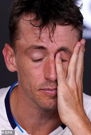 John Millman of Australia speaks during a press conference following his loss to Roger Federer