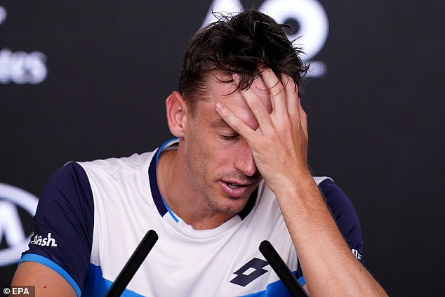 Millman looks devastated after the loss in the fifth set to Roger Federer