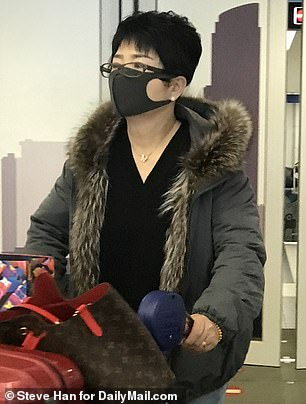 Officials updated its warning from level 2, which means to exercise increased caution, to level 4, which suggests 'do not travel.' Pictured: Travelers with masks at O'Hare Airport on Thursday