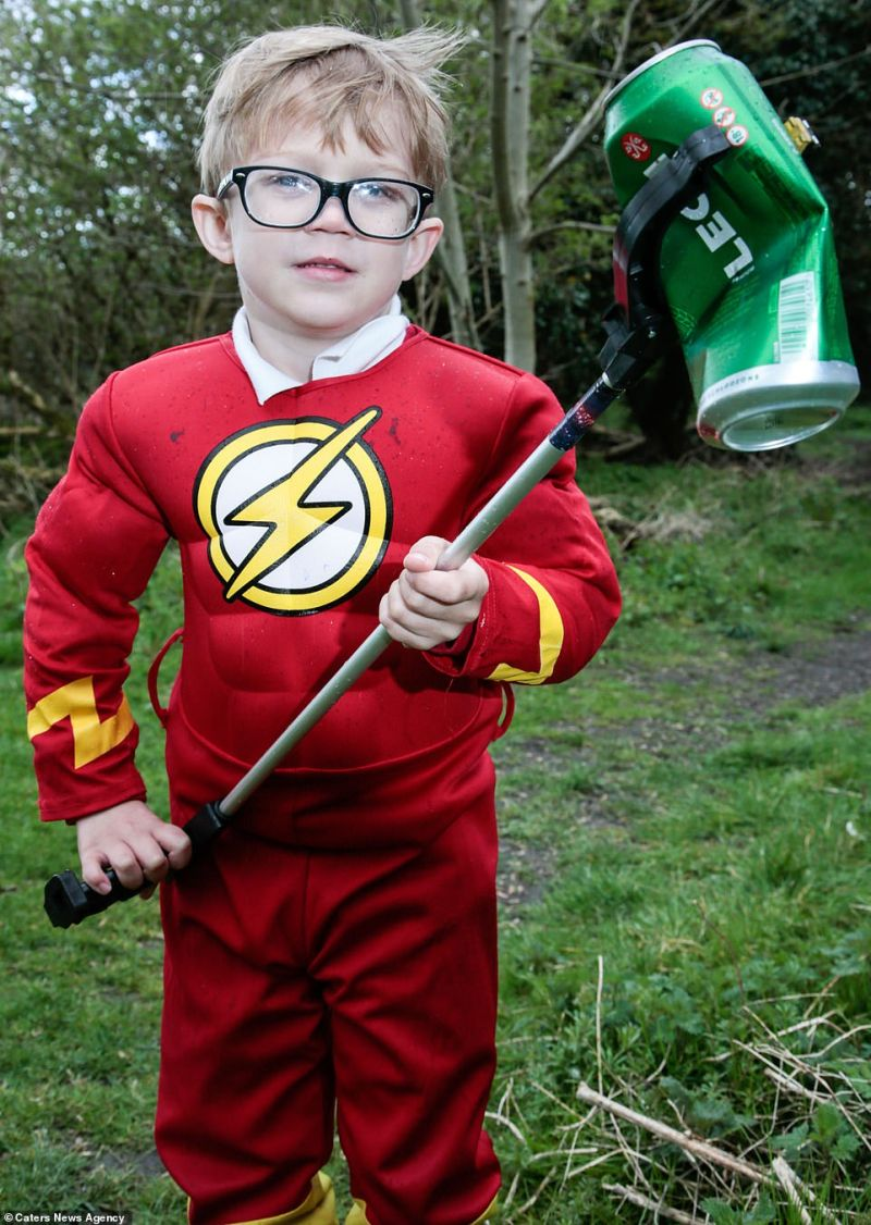 Flash mob: Superhero Parker Lawrie, four, of Walsall pictured last year armed with a litter picker as he cleans the countryside