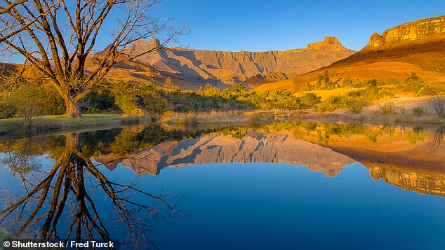 In South Africa, you can see the Big Five as well as go on a walking tour in the Drakensberg Mountains, pictured