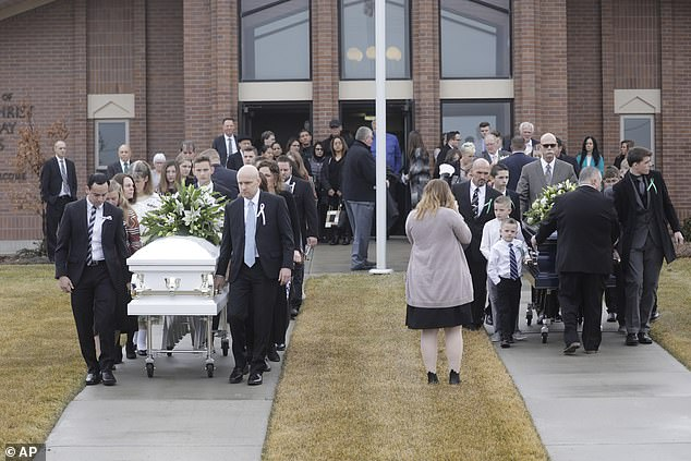 Mourners gathered at the church on Friday afternoon for the funerals of the four family members