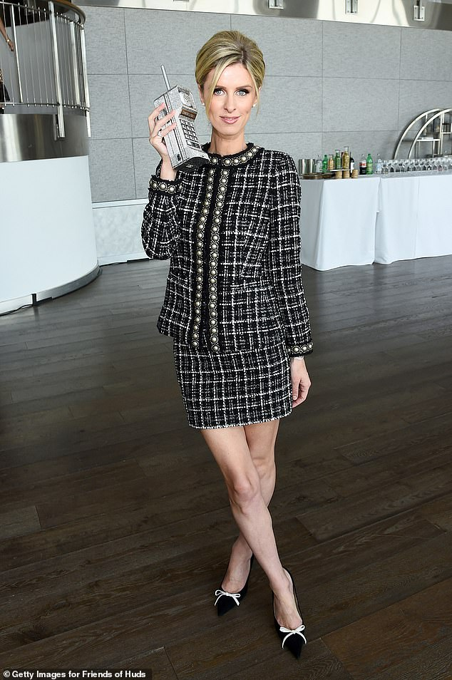 Leggy mama: Nicky Hilton was as chic as can be on Friday afternoon in New York City. The sister of Paris Hilton had on a smart, conservative suit that showed off her legs at the Hudson River Park Friends Playground Committee luncheon at Current at Chelsea Piers in NYC