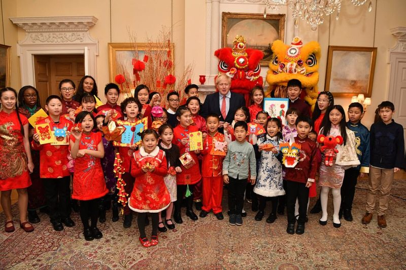 Pictured: Boris Johnson celebrating Chinese New Year.Pressure is now mounting on the government to ramp up Britain's response and screen all passengers on flights from China