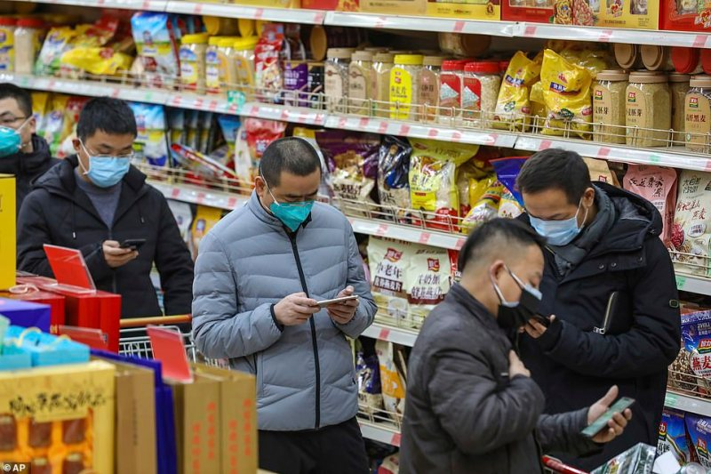 """Residents in Wuhan were stocking up on masks, gloves and disinfectant. """"Everyone is just trying to protect themselves,"""" said a man in a surgical mask at a busy pharmacy"""