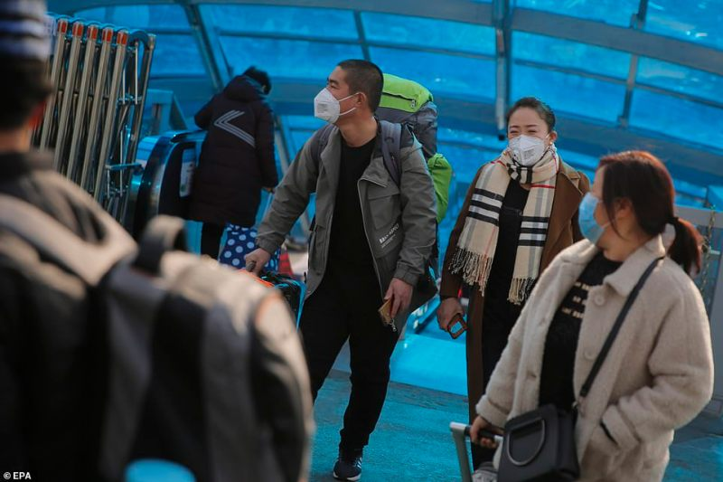 Passengers at the Beijing Railway Station were today pictured wearing face masks amid fears of the outbreak spreading to the capital. Major Lunar New Year celebrations have been cancelled in the city